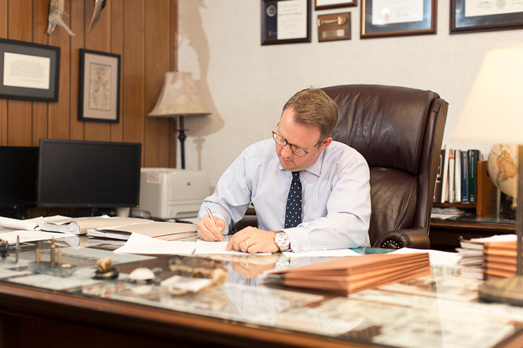 Patrick at his desk